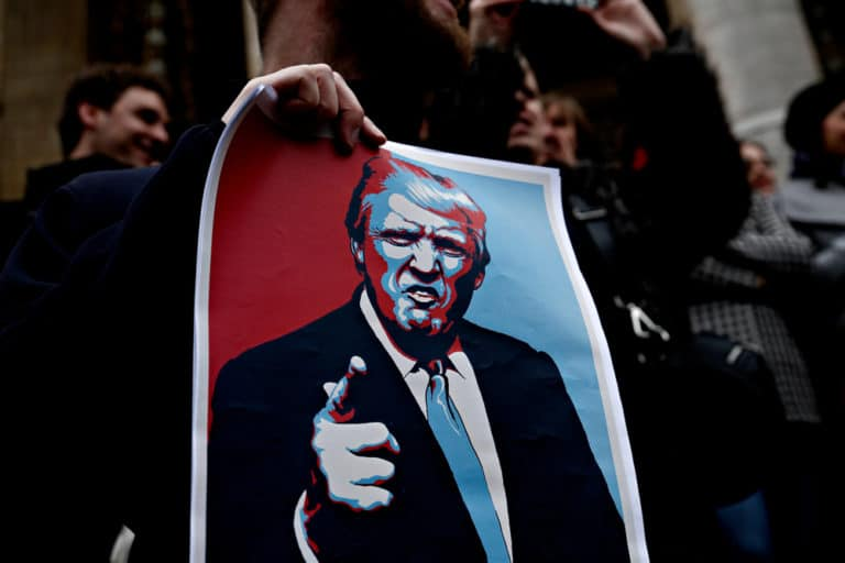 Protesters against Trump imposing controls on travelers from Iran